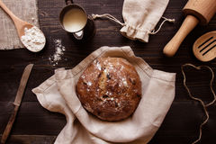 Fresh homemade bread on the dark wooden background top view Stock Photography