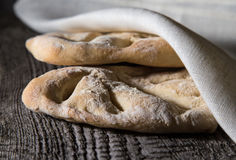 Fresh homemade bread on light grey table. Selective focus. Shall. Ow depth of field royalty free stock image