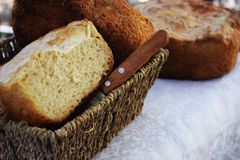 Fresh homemade bread only from the oven and immediately on the table. Fresh, delicious hot homemade bread baking in the oven and immediately serving on the table royalty free stock image