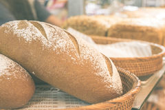 Fresh homemade bread placed on a wooden basket in the shopping mall italian bakery. Bali island, Indonesia. Stock Photos
