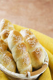 Fresh homemade bread rolls with sesam seed in basket on wooden t Royalty Free Stock Photo
