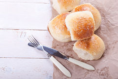 Fresh homemade bread rolls. With sesam seed on table Royalty Free Stock Images