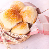 Fresh homemade bread rolls. With sesam seed on table Royalty Free Stock Photography