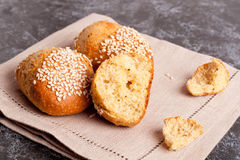 Fresh homemade bread rolls with sesam seed on table. Close up, horizontal Stock Image