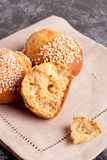 Fresh homemade bread rolls with sesam seed on table. Close up, vertical, top view Stock Photo