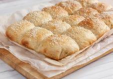 Fresh homemade bread rolls. With sesam seeds on table stock photos