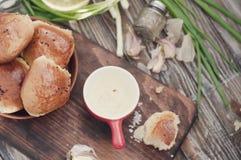 Fresh homemade bread rolls . Toned photo. Fresh homemade bread rolls with sesam seed on table . Toned photo Stock Photography