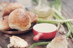 Fresh homemade bread rolls . Toned photo. Fresh homemade bread rolls with sesam seed on table . Toned photo Stock Image