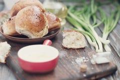 Fresh homemade bread rolls . Toned photo. Fresh homemade bread rolls with sesam seed on table . Toned photo Royalty Free Stock Photos