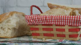 Fresh Homemade Bread Sliced in a Basket on the Table royalty free stock photos