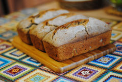 Fresh homemade bread on wooden board. Fresh unleavened homemade bread on wooden board Stock Photography
