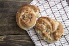 Fresh homemade bread on wooden table Stock Photos