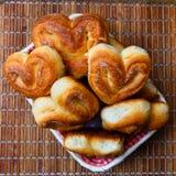 Fresh homemade buns on the bamboo tray, top view Stock Photos