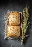 Fresh and homemade buns with sesame seeds. On wooden table royalty free stock photos