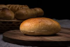 Fresh homemade burger bread buns on dark wood background royalty free stock image