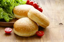 Fresh homemade burger buns. On a wooden table Royalty Free Stock Photography
