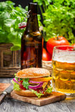Fresh homemade burger and a cold beer Royalty Free Stock Photo
