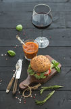 Fresh homemade burger on dark serving board with stock photos