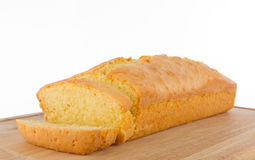 Fresh homemade butter cake on cutting board Stock Images