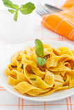 Fresh homemade carrot pasta. With mint sauce Royalty Free Stock Photography