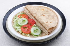Fresh homemade chapati and vegetables. Fresh homemade chapati,{Indian unleavened flatbread } with fresh vegetables Stock Photo