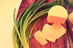 Fresh homemade cheese for serving. Still life of homemade cheese and green onions Stock Photo