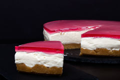 Fresh homemade cheesecake with pink jelly. Shallow depth of fiel Stock Images