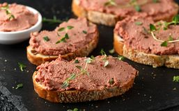 Fresh homemade chicken liver pate on bread royalty free stock photography