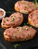 Fresh homemade chicken liver pate on bread stock photography