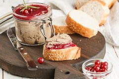 Fresh homemade chicken liver pate rabbit, goose. With cranberry sauce. Gourmet appetizer. Selective focus royalty free stock photography