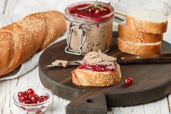 Fresh homemade chicken liver pate rabbit, goose. With cranberry sauce. Gourmet appetizer. Selective focus stock image