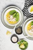 Fresh homemade chicken soup broth with corn, spinach, boiled breast on a light background. Top view. Copy space. Fresh homemade chicken soup broth with corn Royalty Free Stock Images