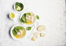 Fresh homemade chicken soup broth with corn, spinach, boiled breast on a light background. Top view. Copy space. Fresh homemade chicken soup broth with corn Royalty Free Stock Photo