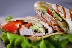 Fresh homemade chicken wrap tortilla. Cutted on salad Stock Photos