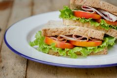 homemade club sandwich with lettuce and tomato Royalty Free Stock Photos