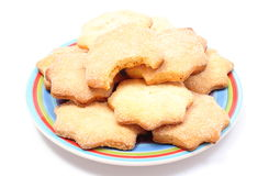 Fresh homemade cookies on colorful plate. White background Stock Photography