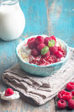 Fresh homemade cottage cheese with raspberries. Fresh homemade cottage cheese with juicy raspberries on rustic wooden table, dietary breakfast for summer time Stock Image