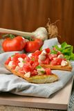 Fresh homemade crispy Italian antipasto called Bruschetta Stock Photo