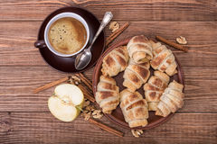 Fresh homemade croissants with apple and cup of coffee. Royalty Free Stock Image