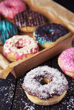 Fresh homemade donuts with various toppings Stock Images