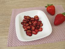 Fresh and dried strawberries Stock Photos