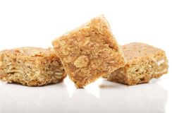 Fresh homemade flapjack oat cake with seeds isolated over white. Stock Photography