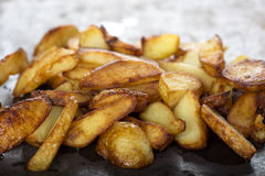 Fresh homemade fried potato wedges Royalty Free Stock Image