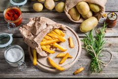 Fresh homemade fries with salt and ketchup Royalty Free Stock Image