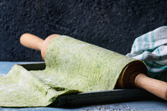 Fresh homemade green dough for pasta Stock Photo