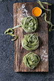 Fresh homemade green pasta tagliatelle Royalty Free Stock Images