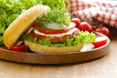 Fresh homemade hamburger with vegetables and salad Royalty Free Stock Photo