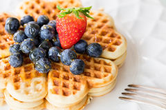 Fresh homemade heart shape waffles with blueberries and strawber Stock Photography
