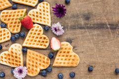 Fresh homemade heart shape waffles with blueberries and strawber Stock Images