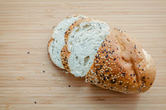 Fresh homemade herbal bread slice on bamboo cutting board. Homem. Ade whole wheat bread baked .  Healthy bread with sesame and herbs Royalty Free Stock Photos